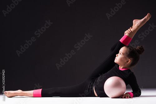 Tuinposter Gymnastiek Teenager girl involved in rhythmic gymnastics