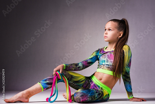 Tuinposter Gymnastiek Teenager girl involved in rhythmic gymnastics