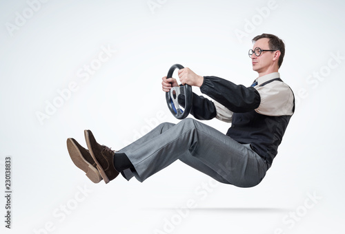 Man accountant with glasses and sleeves is driving a car with steering wheel Canvas-taulu