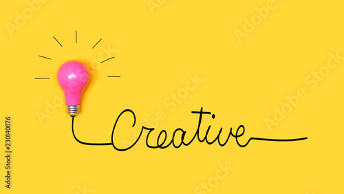 Creative hand wiriting text with light bulb