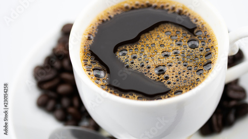 Wall Murals Cafe Coffee cup and coffee beans on white background.
