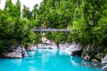 Hokitika Gorge, West Coast, New Zealand. Beautiful Nature With Blueturquoise Color Water And Wooden Swing Bridge.
