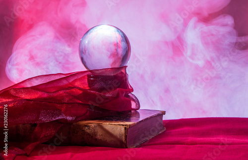 Fotografia  Still life with a crystal ball for fortune telling