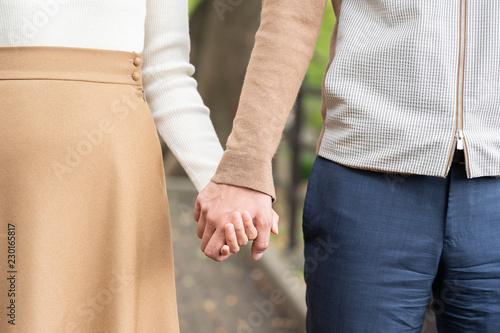 Photo 手を繋ぐカップル