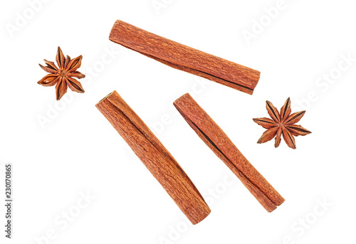 Cinnamon sticks with anise stars isolated on white background Wallpaper Mural