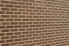 Vintage Brown Color Brick Wall Background In Traditional Running Bond Pattern (angle View)