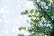 Leinwanddruck Bild - Closeup of Christmas tree with light, snow flake. Christmas and New Year holiday background. vintage color tone.