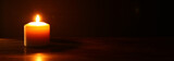 Burning candles over black background.