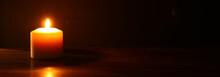 Burning Candles Over Black Bac...