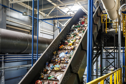 Fototapeta  moving conveyor transporter on Modern waste recycling processing plant