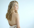 canvas print picture - Young blond woman looking away