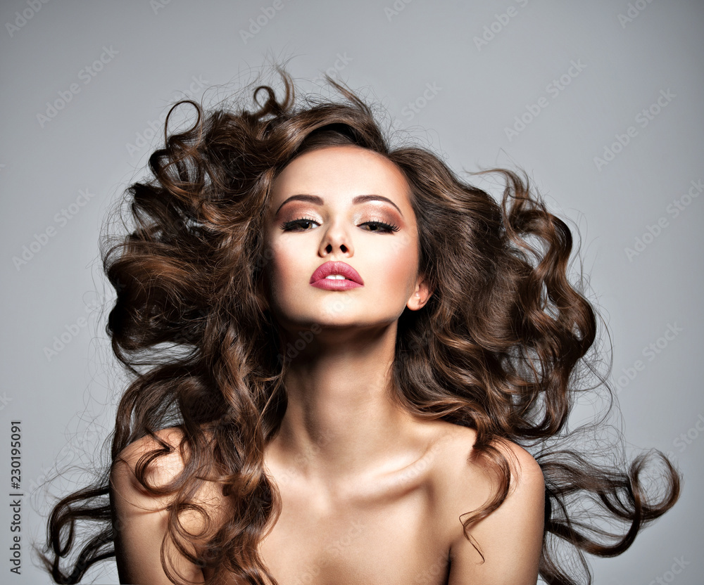 Fototapeta Face of a beautiful  woman with long flying   hair