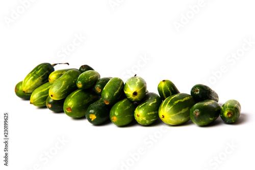 Fotografie, Obraz  Pointed gourd vegetables on white background
