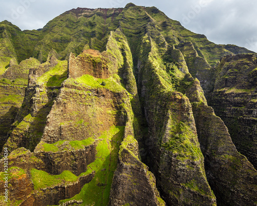 Wall Murals Pale violet Rugged cliffs of the monumental Na Pali Coast, aerial shot from a helicopter, Kauai, Hawaii.