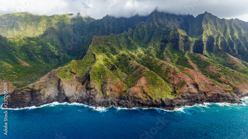 Photo View of the monumental Na Pali Coast at Kaa Alahina Ridge and Manono Ridge, Kalalau trail visible if zoomed in