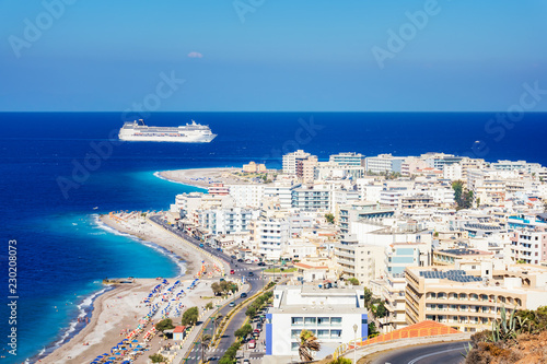 View of Aegean coast of City of Rhodes and cruise ship (Rhodes, Greece).