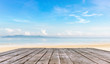 wooden table top or wooden plank in front of the beach background