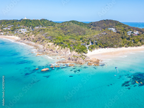 Fotografia The Pass and Wategoes at Byron Bay from an aerial view with blue water