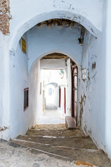 Narrow medieval street in the white medina of the Tetouan city, Morocco in Africa