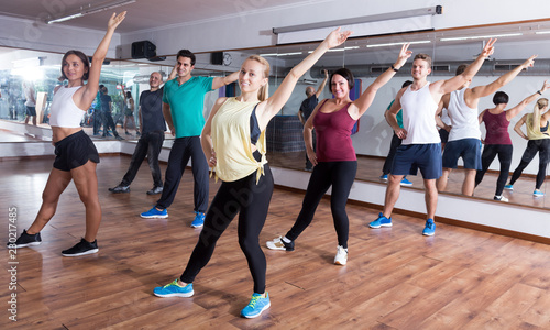 Canvas Print Happy people exercising zumba elements together