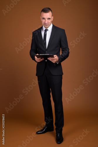 Fotografie, Obraz  Full length shot of businessman standing and wearing suit