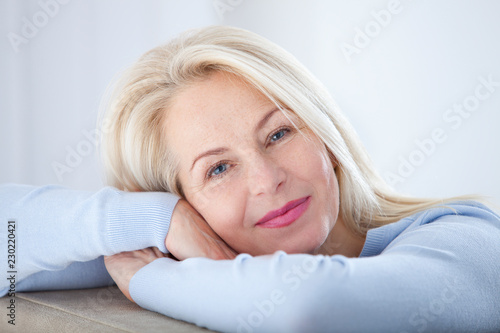 Fotografie, Obraz  Active beautiful middle-aged woman smiling friendly and looking in camera