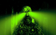 Dark Zombie With Green Rays From The Eyes In Dungeon.
