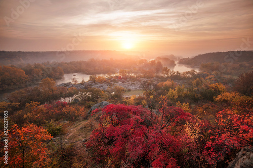 In de dag Zalm amazing panoramic view of blue foggy river and colorful forest on sunrise. autumn landscape