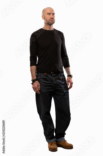Bald brutal man in full height Tablou Canvas