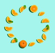 Fresh Orange Circle On A Pastel Blue Background Flat Lay