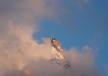 Clouds And Fog Hide The Famous Aiguille Du Midi Station At Sunrise In The French Alps