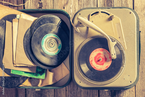 Record player and vinyls as toned and filtered photo - 230246479