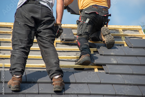 two carpenters working on roof Fototapeta