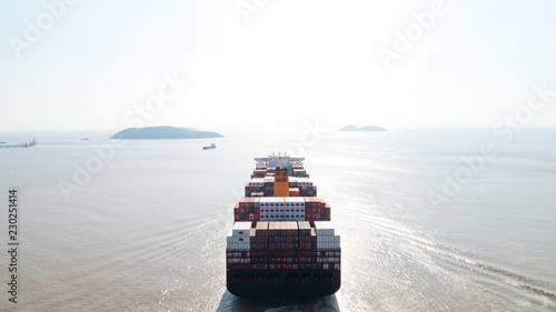 Aerial top view container cargo ship in import export business logistic and transportation of international by container cargo ship in the open sea