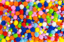 Background Of Brightly Colored Pom-poms