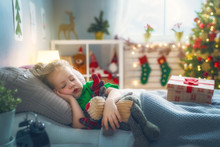 Girl Sleeping Near Christmas T...