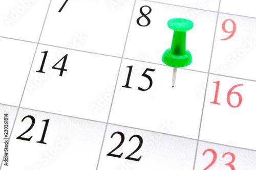 Fotografie, Obraz  stuck stationery green pushpin in a sheet of monthly calendar