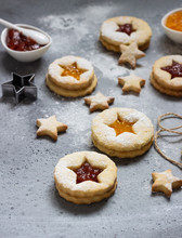 Christmas Or New Year Homemade Cookies With Red And Orange Jam. Flat Lay. Traditional Austrian Christmas Cookies - Linzer Biscuits Filled With Jam. Top View. Copy Space.