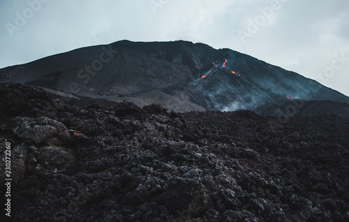 Fotografie, Obraz  Small volcanic rock and lava flow down Pacaya Volcano, one of Guatemala's most a