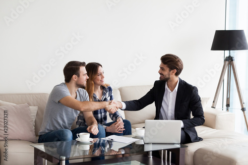 Fotografía  Young couple, family at meeting with realtor, interior designer, decorator, landlord making deal