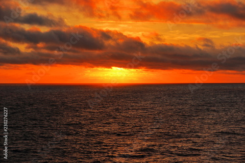 A color image of the sun setting over the North Sea as seen from the balcony of a cruise ship.