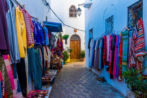Street souvenyrs market in ancient white medina of the Asilah Village in Morocco