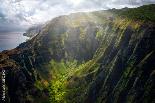 Landscape view of Na Pali coastline cliffs with sunlight glow, Kauai, Hawaii