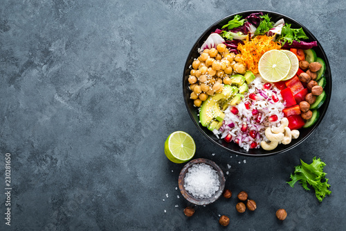 Türaufkleber Buddha Healthy vegetarian Buddha bowl with fresh vegetable salad, rice, chickpea, avocado, sweet pepper, cucumber, carrot, pomegranate and nuts closeup