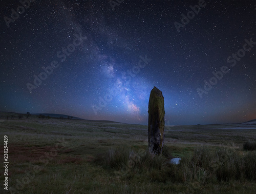 Fotografie, Obraz  Vibrant Milky Way composite image over landscape of Ancient prehistoric stones i
