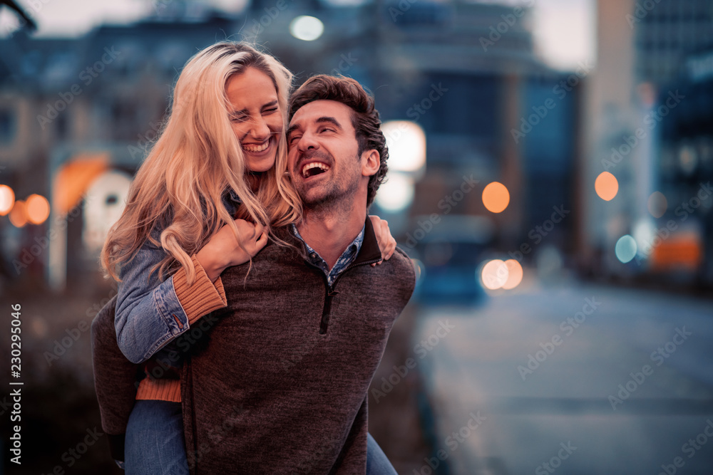 Fototapety, obrazy: Young couple in love hug each other outdoors