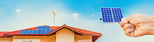 Solar Panel Installation On The Roof Of A House On Sunny Day - Solar Energy Concept Image.