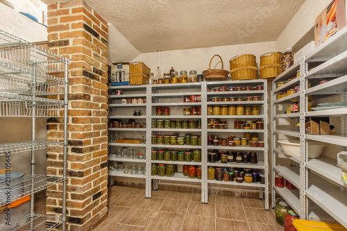 Fototapeta Home food storage room. Various jars with Home Canning Fruits and Vegetables jam on shelves obraz