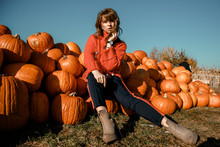 Young Woman On A Pumpkin Farm....