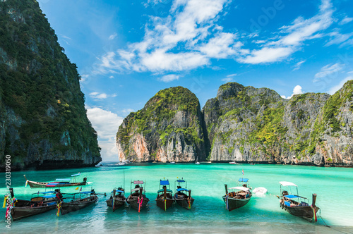 Photo Stands Black Maya Bay in Ko Phi Phi Le island, Krabi Province, Thailand. South East Asia.
